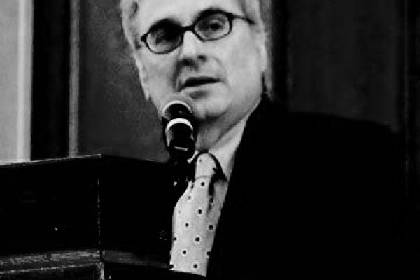 Portrait of Jim Burnstein giving a lecture in Black and White